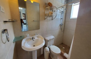 ensuite bathroom with rain shower